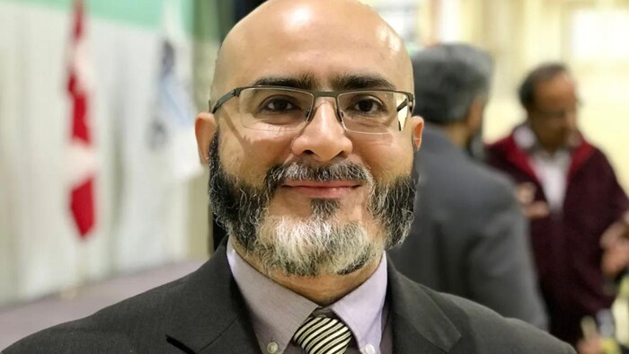 Close-up on Dr. Mukarram Zaidi.