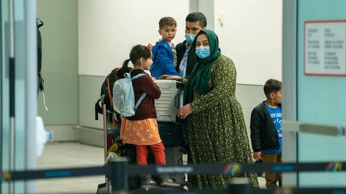 photo shows passengers inside Toronto's Pearson International Airport Feb. 23, 2021.