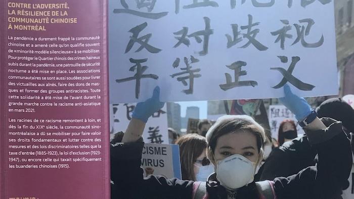 蒙城唐人街正在进行的图片展,展示2021年,反针对亚裔仇视大游行的情景。