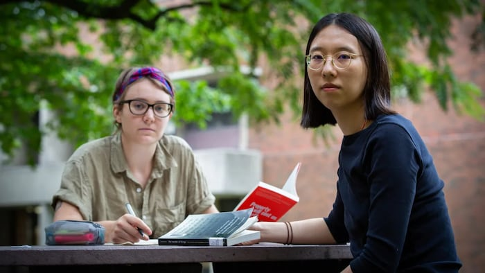 M.A. students Grace Cameron, left, and Rui Liu study at the Women and Gender Studies Institute at the University of Toronto. They argue that the institution of the university has always been in crisis.