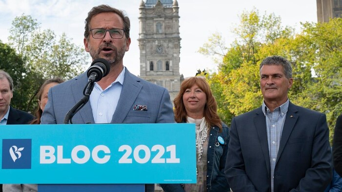Bloc Québécois Leader Yves-Francois Blanchet during a news conference Sept. 18, with candidate Louis Sansfacon in Quebec City. The leader is standing in front of microphone.