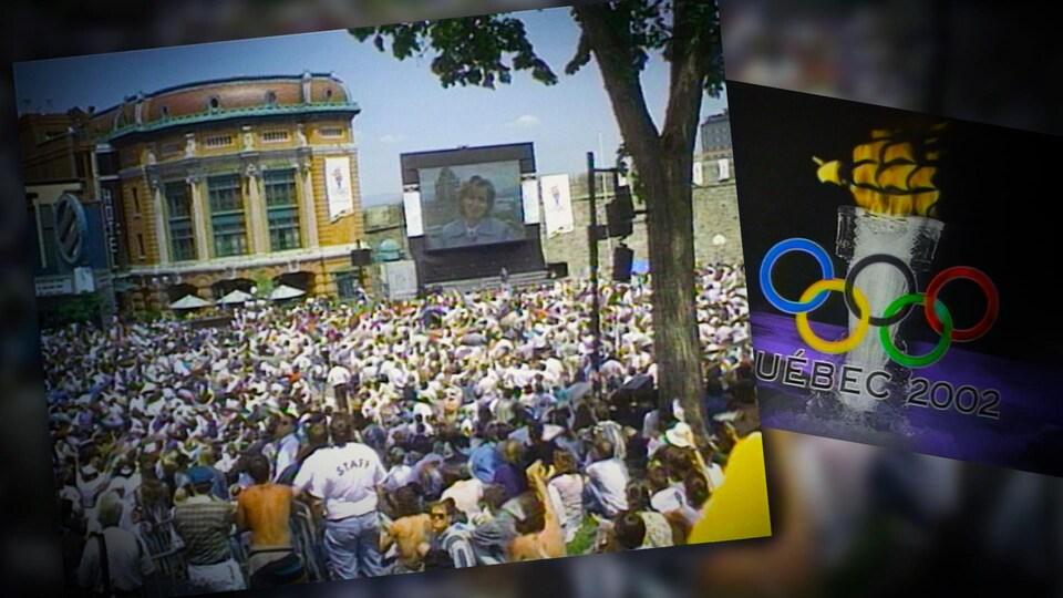 Une foule réunie à la place D'Youville regarde un écran géant.