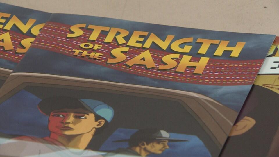 Plan serré de la couverture de la bande dessinée intitulée « Strength of the sash » : la force de la ceinture fléchée.