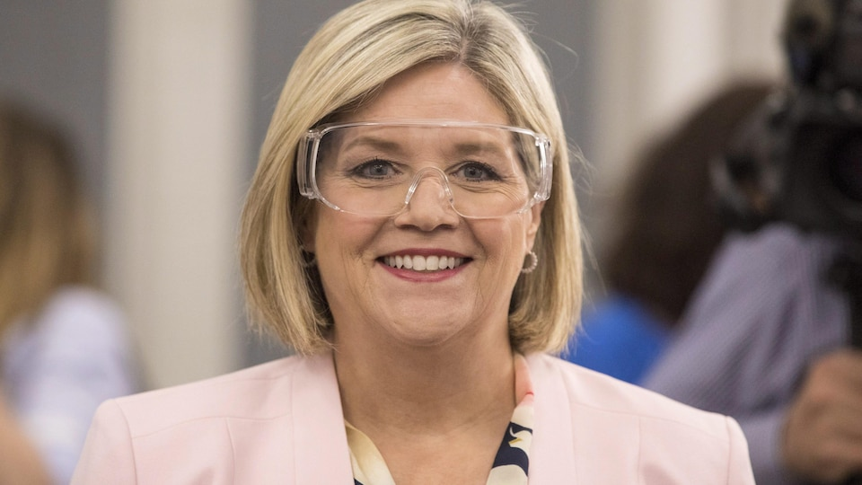 Ontario NDP Leader Andrea Horwath dons a pair of safety glasses during a visit to a mechatronics lab at Seneca College in Toronto, on Wednesday, May 23, 2018. THE CANADIAN PRESS/Chris Young