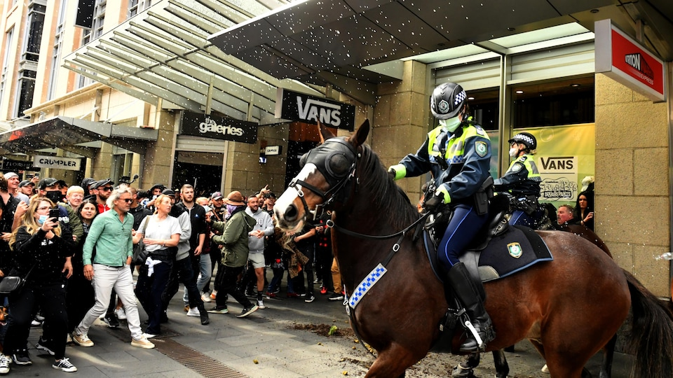 Clashes between protesters and mounted police in Sydney.