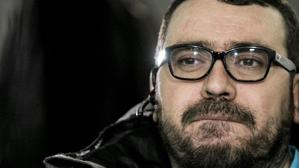 Plan serré d'Aymen Derbali, devenu tétraplégique après l'attentat à la mosquée de Québec.
