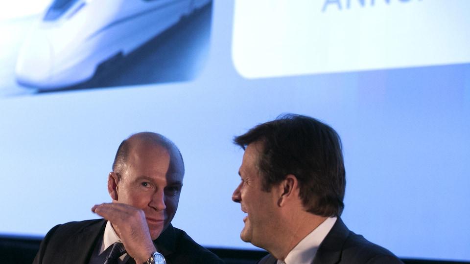 [De gauche à droite] Le président et chef de la direction de Bombardier, Alain Bellemare en compagnie du président exécutif du C.A., Pierre Beaudoin