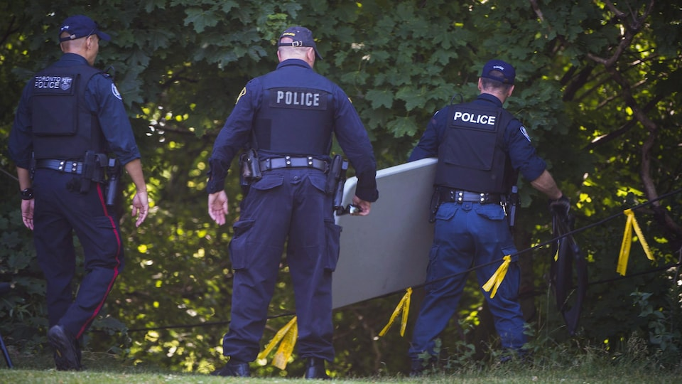 Police investigate the a property along Mallory Cres. in Toronto as part of the Bruce McArthur investigation on Wednesday, July 4, 2018. THE CANADIAN PRESS/Tijana Martin