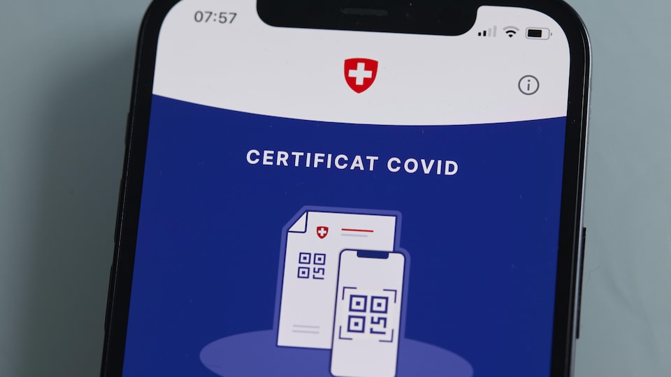 COVID certificate on cell phone, with Swiss flag.