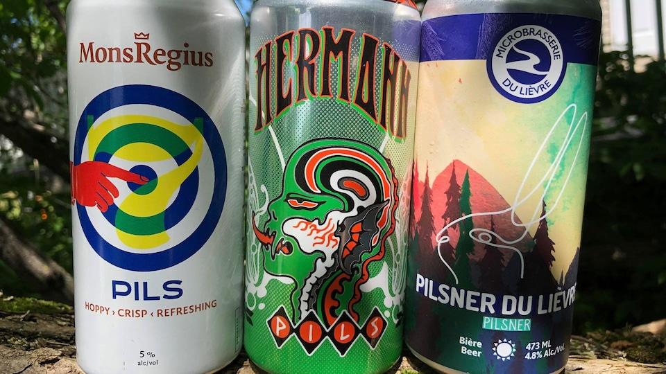 Trois cannettes de bière côte à côte.