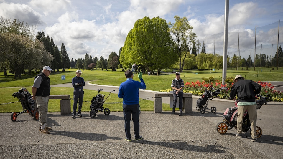 Golfers are pictured at the reopening of the McCleery Golf Club in Vancouver, British Columbia on Friday, May 1, 2020.