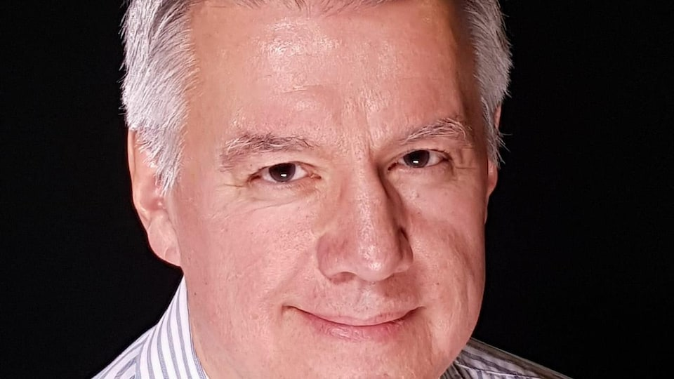 Portrait de Don Crawford qui sourit