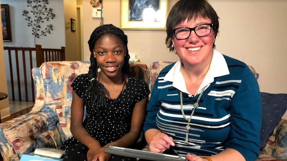 Elyse Dupuis et sa fille Rosalie, adoptée en Haïti.