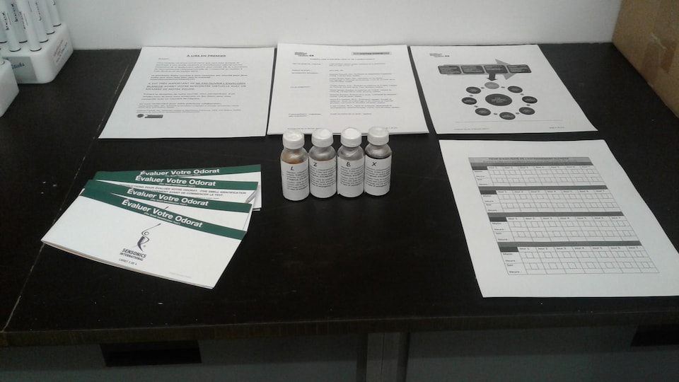 Essential oil and questionnaire bottles on a table.