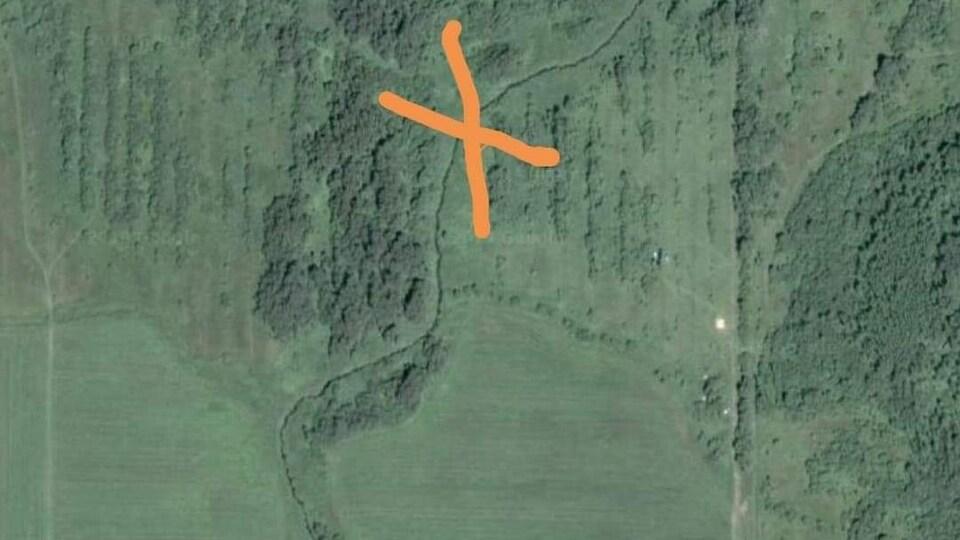C'est une carte des 2e et 3e rangs ouest à Macamic. Un X se trouve au milieu de la forêt.