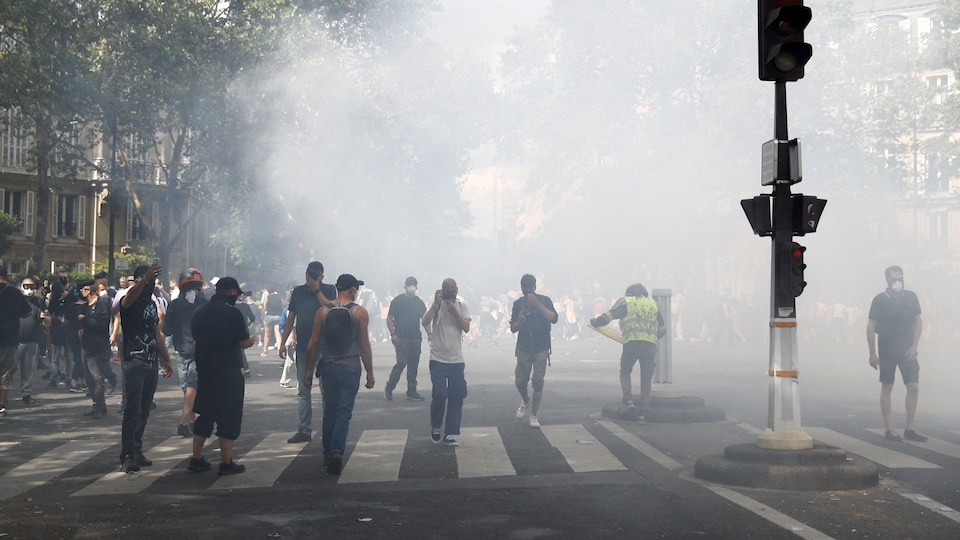 Protesters amid tear gas fumes in Paris.