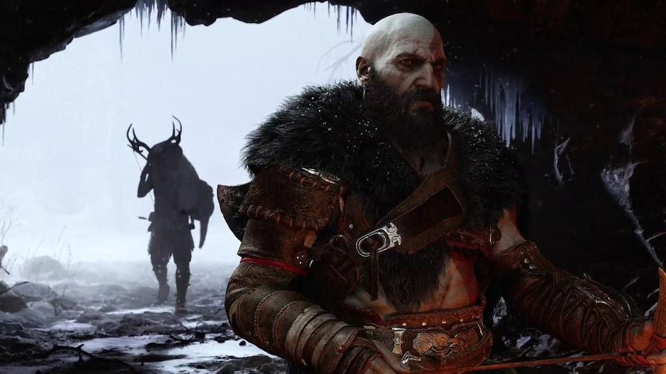 Deux personnages guerriers dans une grotte par temps froid, dans un jeu vidéo.