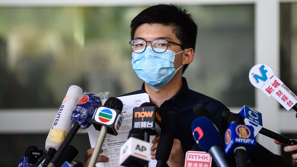 Joshua Wong lors d'un point de presse le 20 juillet dernier annonçant son intention de se présenter aux élections du Conseil législatif.