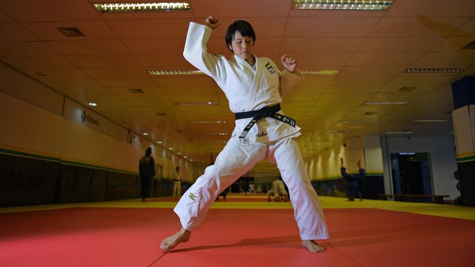 Japanese 35-year-old black belt Yuko Fujii, head coach of the Brazilian men's national team, warms up before giving a class in Rio de Janeiro, Brazil, on June 26, 2018. - Fujii, who previously was an assistant coach with the squad, has made history by becoming in May 2018 one of the very few women in the world to head any top-level male sports team, let alone judo. (Photo by Carl DE SOUZA / AFP)        (Photo credit should read CARL DE SOUZA/AFP/Getty Images)