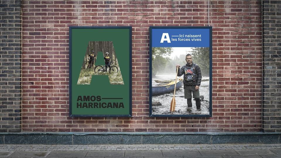 Deux affiches d'Amos Harricana posées sur un mur de brique.