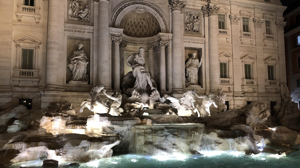 The Trevi fountain at night.