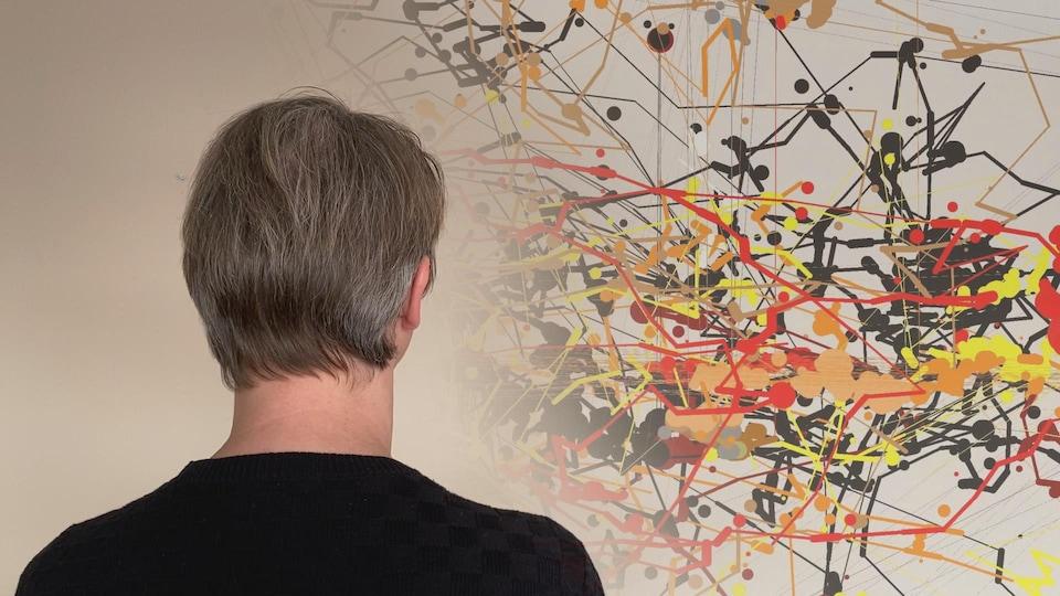 Jan-Willem van Prooijen regarde une toile de Jackson Pollock