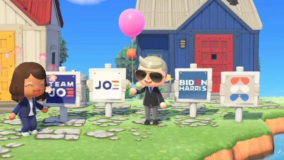 Des versions virtuelles de Joe Biden et sa colistière Kamala Harris dans le jeu Animal Crossing, devant des pancartes virtuelles de leur campagne.