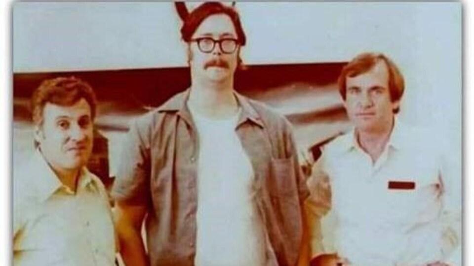 Photo d'archives représentant les trois hommes.