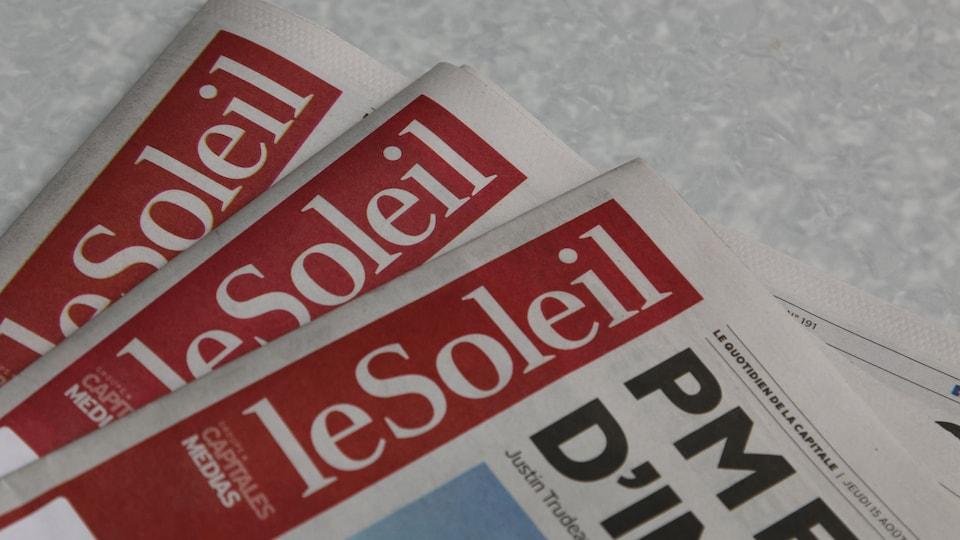 Trois exemplaires où l'on peut voir le nom du journal Le Soleil.
