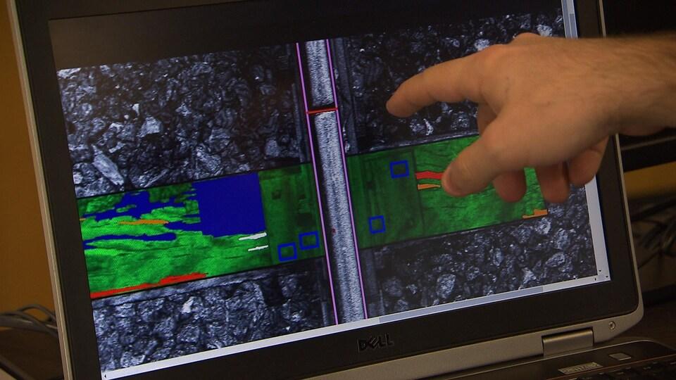 Image rendue par une caméra fixée à l'essieu d'une locomotive pour détecter l'espacement anormal entre les rails