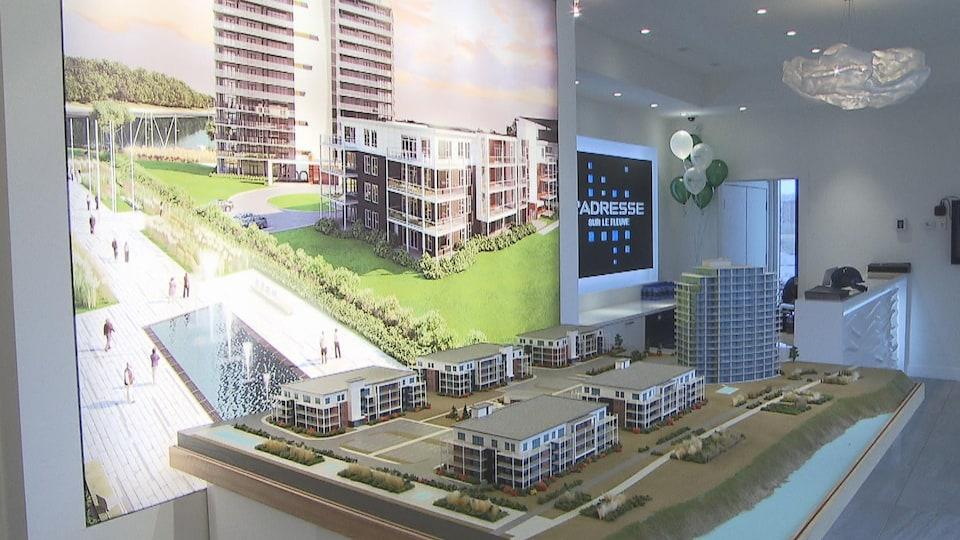 Maquette où on voit 5 immeubles à condos et une tour à 16 étages