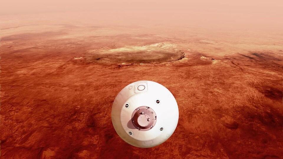 Le bouclier thermique enveloppant le rover Perseverance se dirige vers la surface martienne en descendant dans l'atmosphère (illustration artistique).