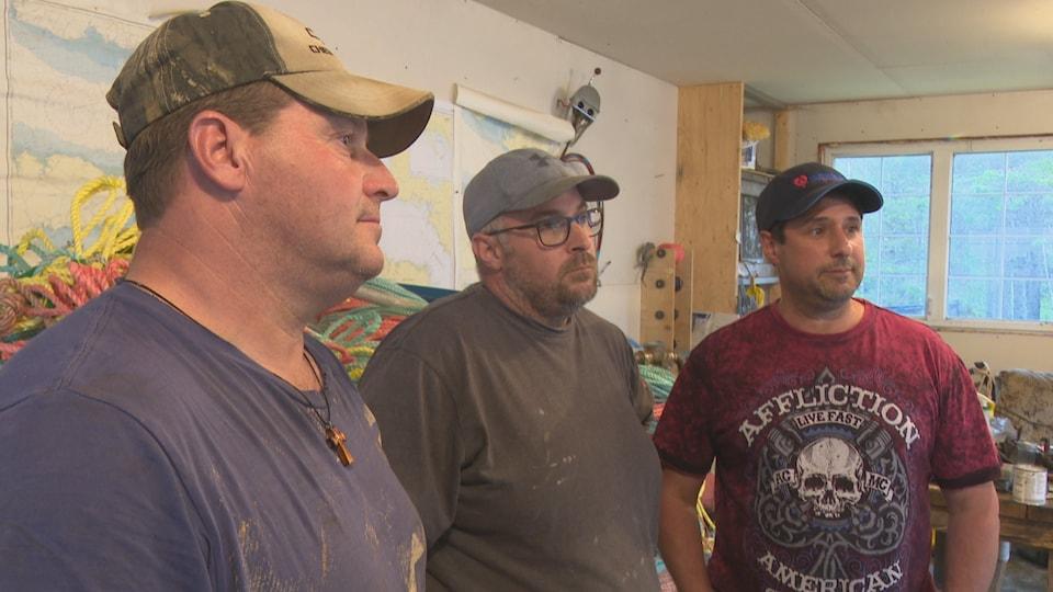 Les pêcheurs Mauril Bourque, Rodney Léger et Jean-Pierre Cormier
