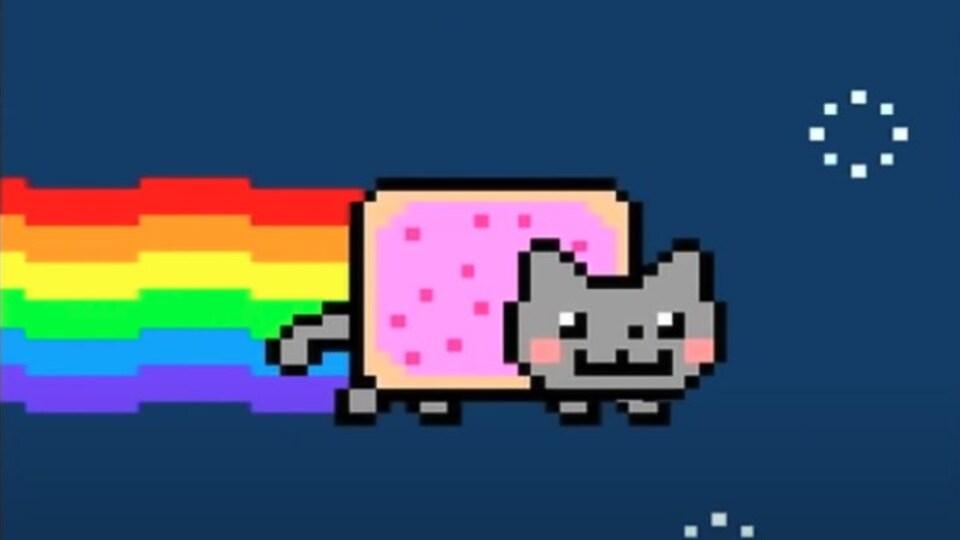 Un chat volant pixélisé laisse une trace arc-en-ciel derrière lui dans un ciel étoilé.