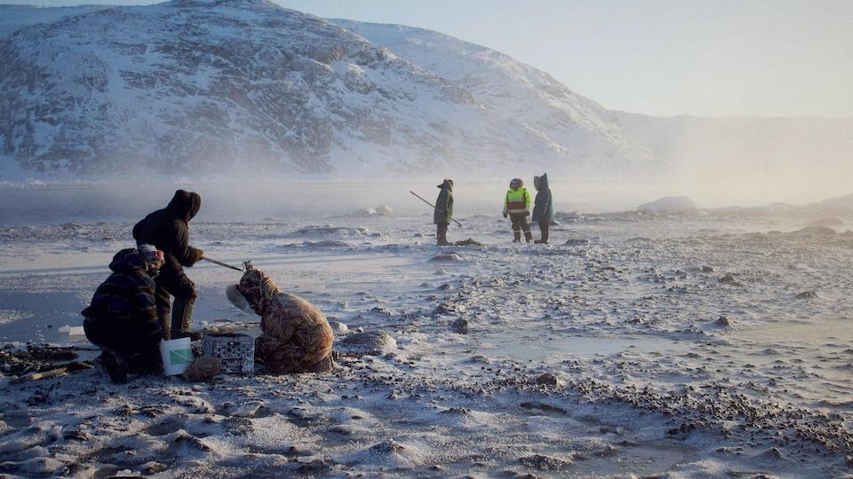 Des pêcheurs de moules.
