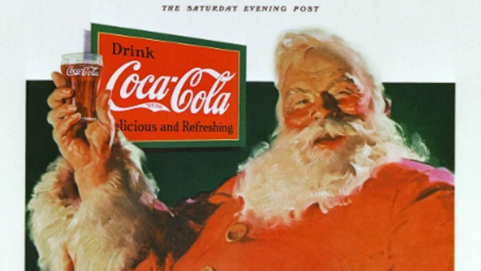 Une publicité peinte à l'huile où le père Noël tient un verre de Coca-Cola.
