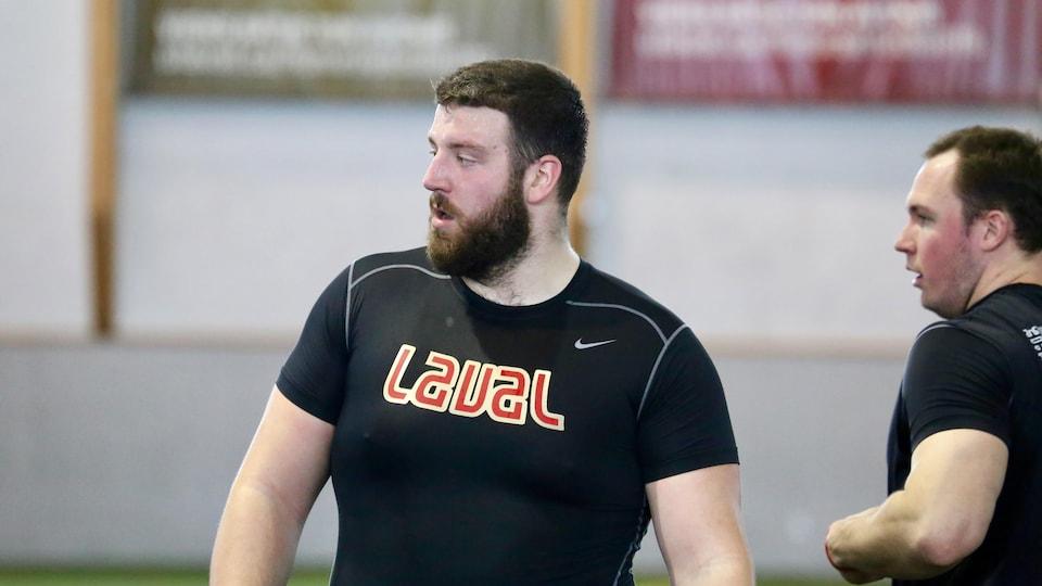 Le joueur de ligne offensive Samuel Thomassin lors d'une journée d'essais professionnels à l'Université Laval, le 11 mars 2019
