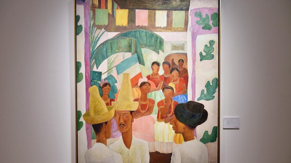Le tableau <i>Los Rivales</i> de Diego Rivera où, en bas à gauche, deux hommes avec chapeau se font face lors d'une célébration traditionnelle mexicaine.