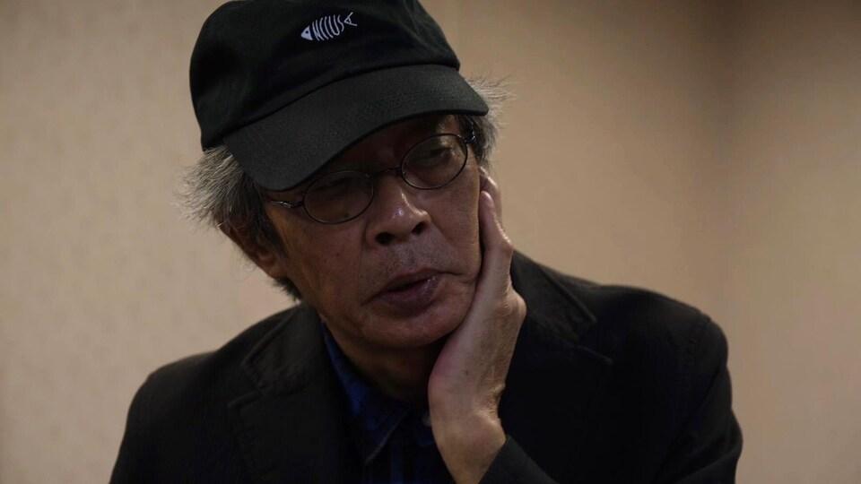 Visage en gros plan de Lam Wing-kee, lors d'une entrevue que le libraire hongkongais accorde à Radio-Canada, dans des locaux vides qu'il compte transformer en librairie à Taipei. 12 janvier 2020