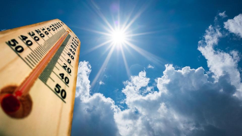 Un thermomètre devant le soleil.