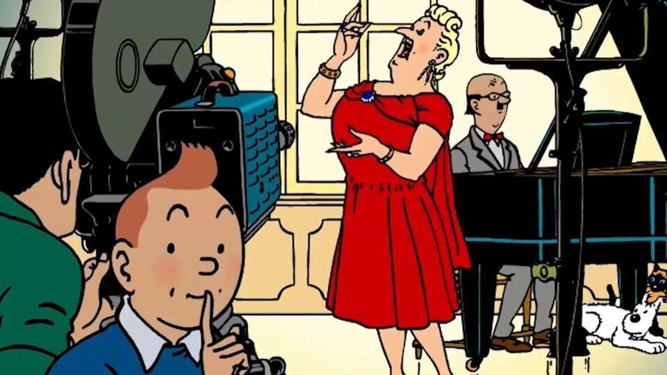 Tintin fait signe de garder le silence en mettant le doigt devant sa bouche alors que la Castafiore chante devant une caméra.