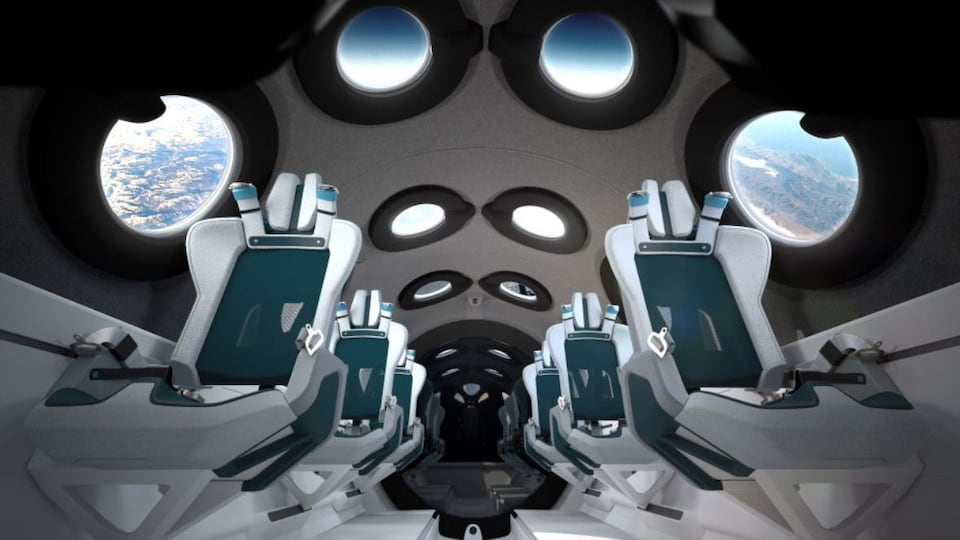 Une représentation de l'intérieur d'un vaisseau spatial pourvu de fenêtres au plafond et sur les côtés.