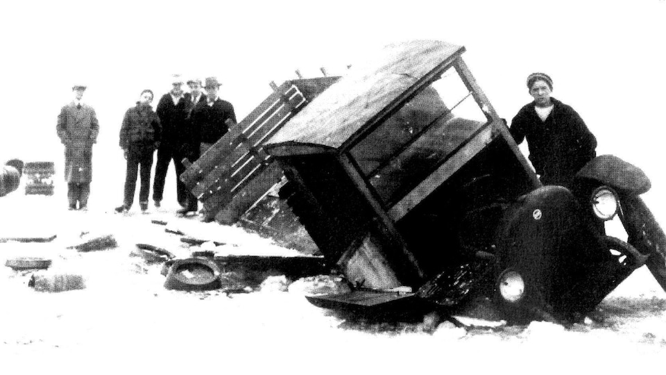 "This beer-laden smuggler's truck was too heavy for ice on Lake St. Clair in the winter of 1933. Several Grosse Pointe residents walked or skated out to witness the accident. Courtesy Detroit News. • Source from ""RumRunning and the Roaring Twenties"""
