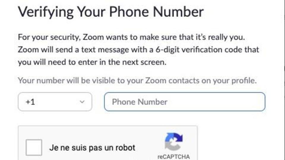 Capture d'écran d'une fenêtre sur le site web de Zoom qui demande à l'internaute de valider son numéro de téléphone afin de vérifier qu'il ne s'agit pas, entre autres, d'un robot.