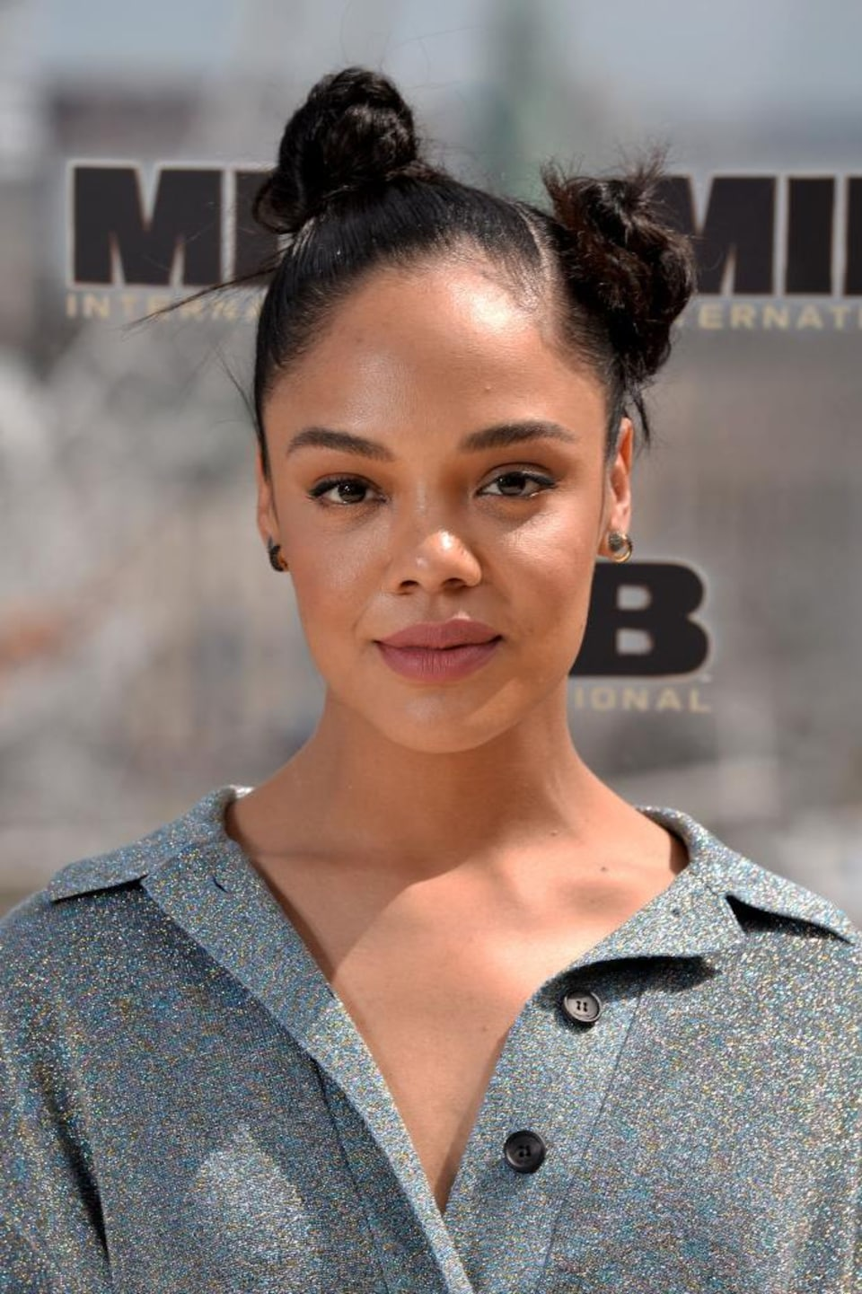 Portrait of Tessa Thompson, hair tied in two buns