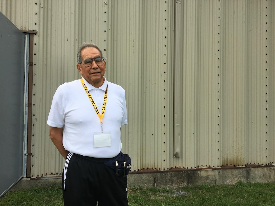 Oliver Hill, a septuagenarian from the Onondaga Nation, posing in front of the Kahnawake Sports Complex.