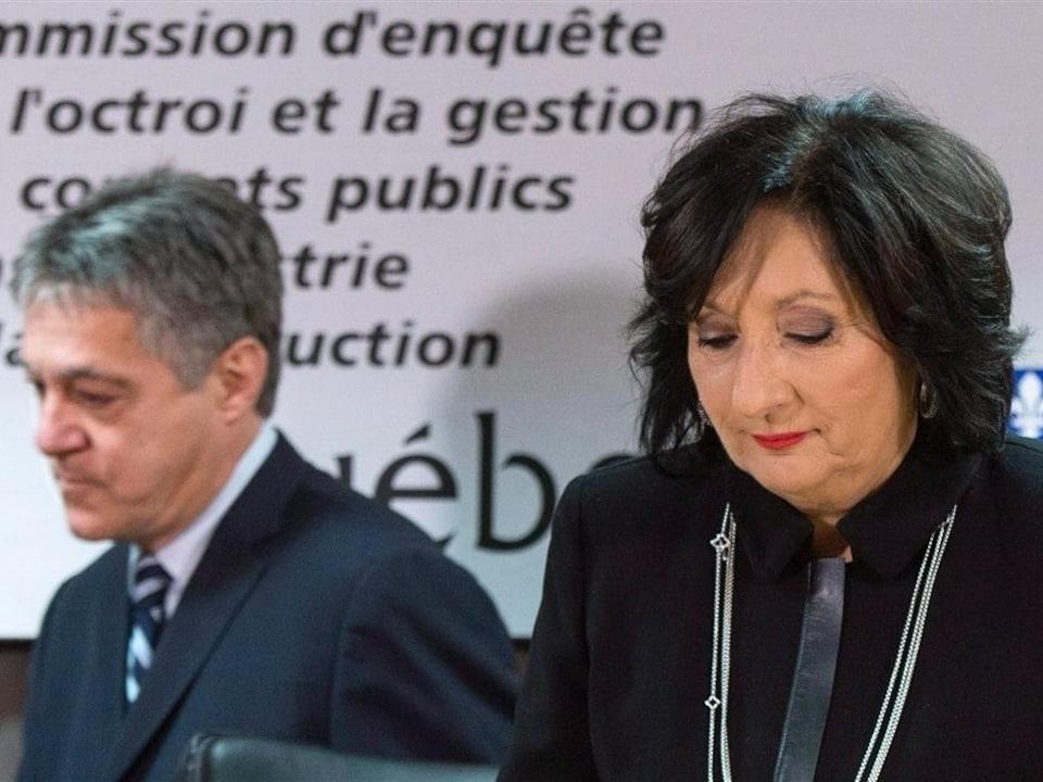 La juge France Charbonneau et le commissaire Renaud Lachance sont assis, côte à côte.