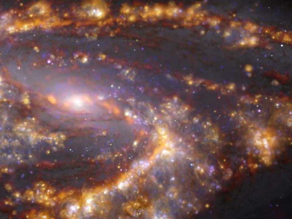 NGC 3627 vue par ALMA dans plusieurs longueurs d'onde de lumière.