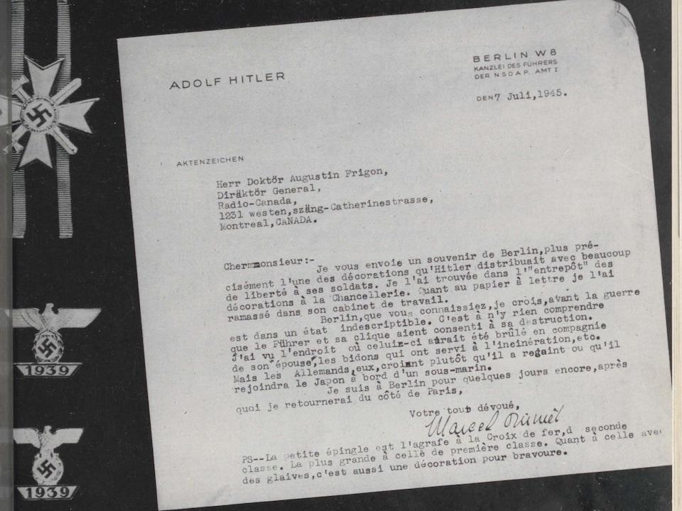 Lettre de Marcel Ouimet dactylographiée sur du papier à lettres du Führer et accompagnée de décorations militaires nazies.