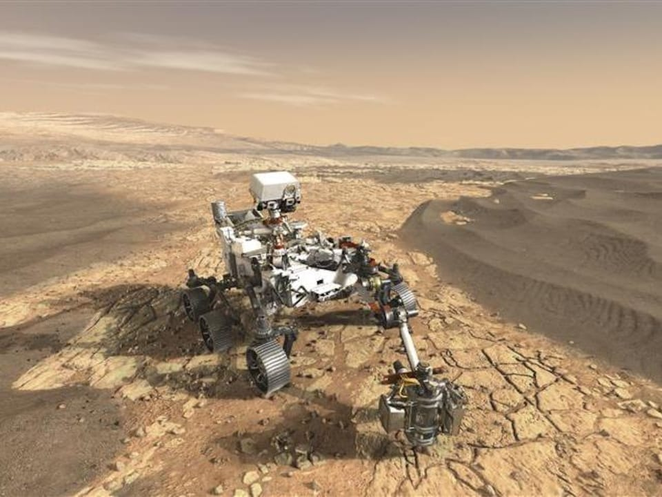 Vue artistique du rover Perseverance sur la surface accidentée de la planète rouge.